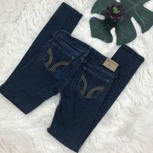 Hollis Low rise skinny dark wash jeans.